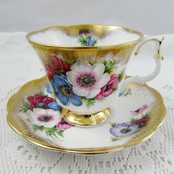 royal albert tea cup and saucer with flowers and heay gold gilt vintage bone china