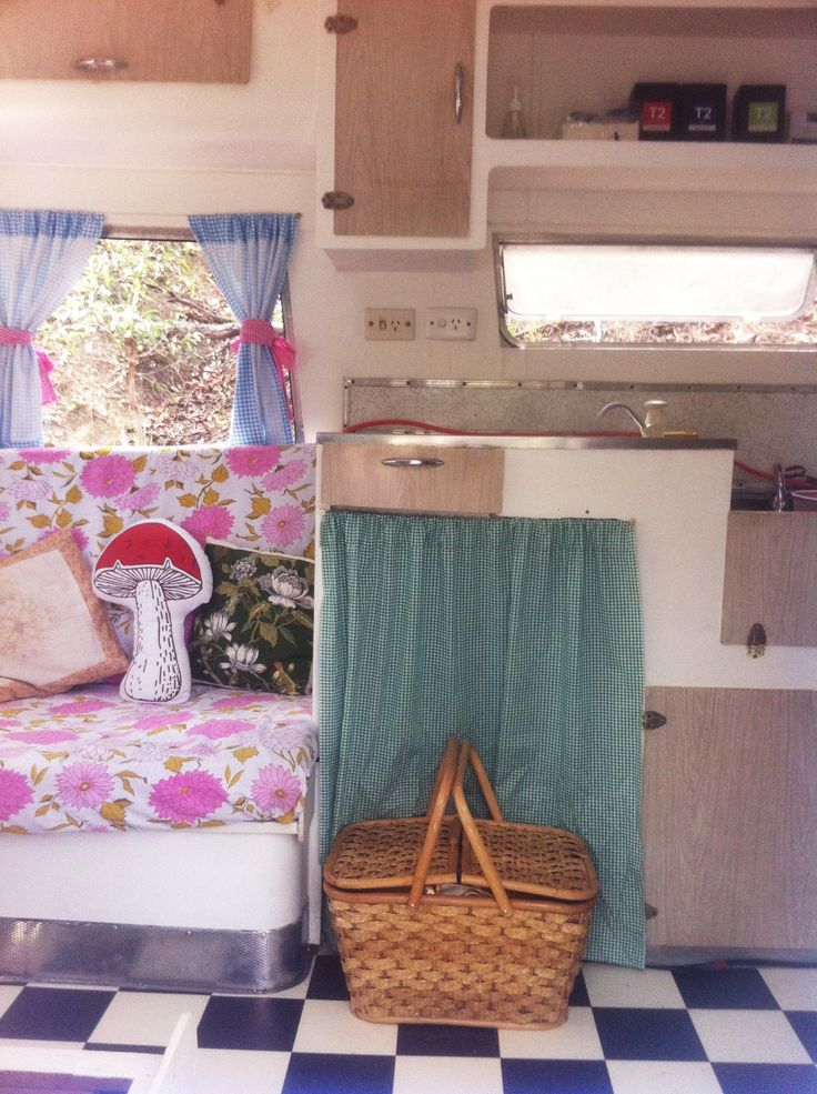 Mushroom & vintage scatter cushions, vintage bed linen seat covers. Vintage picnic basket filled with goodies. #thecuriouscaravan