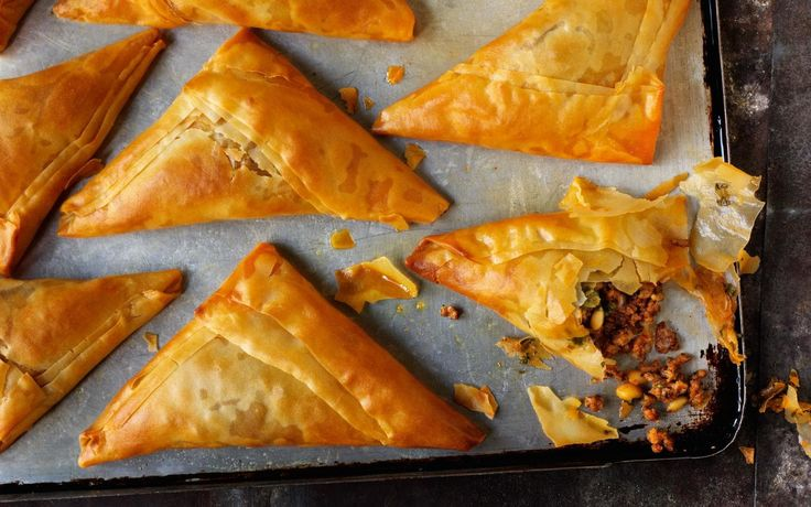 Thin, crispy pastry is filled with a cumin, cinnamon and chilli spiced lamb with pine nuts, red onion and parsley