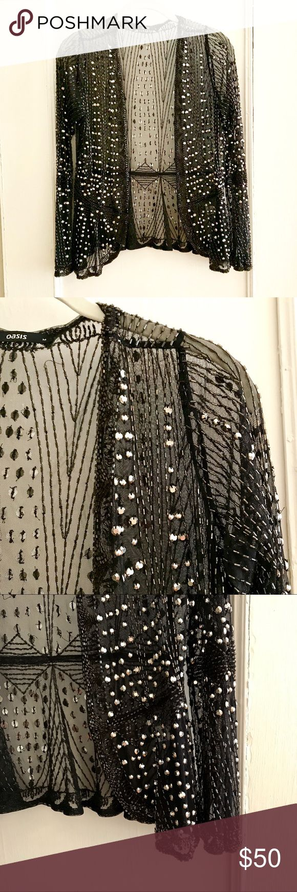 Oasis Beaded Jacket - Size Medium A gorgeous rockstar worthy beaded Oasis jacket in size medium. Sheer black with beads & studs mostly intact (missing beads not noticeable). Pair with a basic black dress or dress up a pair of skinny jeans! Oasis Jackets & Coats