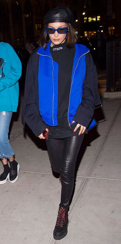 Bella Hadid gave us supermodel cool when she stepped out in combat boots, leather skinnies, and an electric blue vest layered over an oversized top. But of course, it's all about the accessories: retro sunglasses and a leather beret.