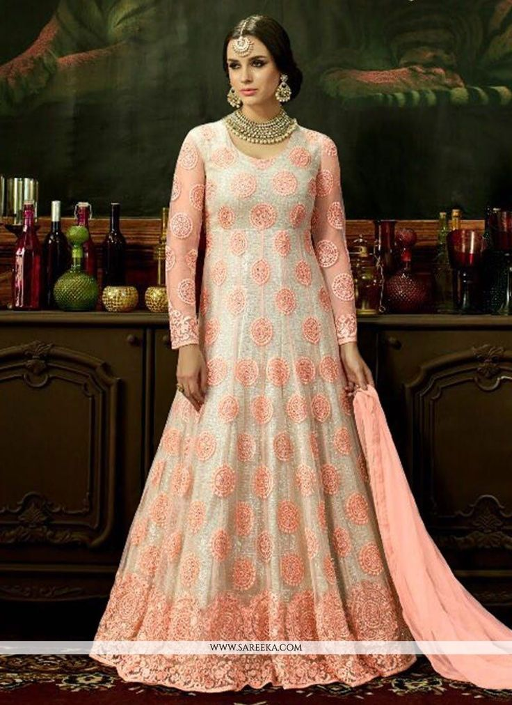 Vogue and trend would be on the peak of your splendor when you dresses this pink and white net floor length anarkali suit. The gorgeous embroidered and resham work a intensive attribute of this attire...