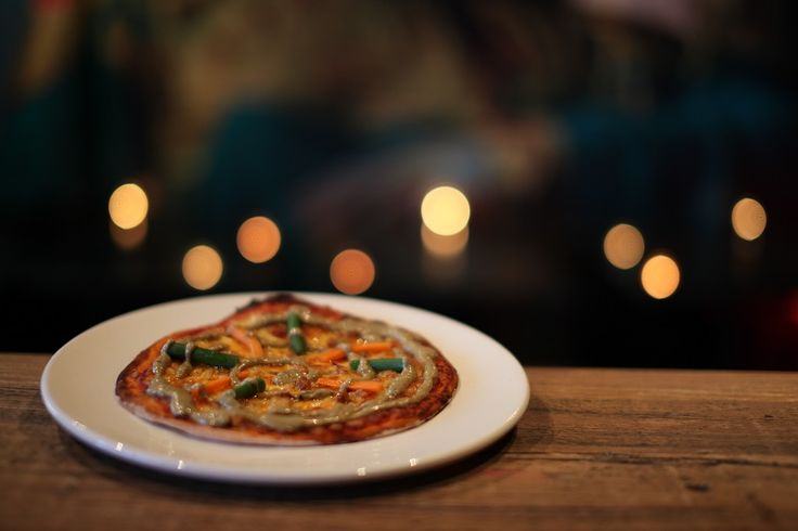 WHERE THE WILD THINGS ARE (THAI GREEN CURRY PIZZA)    Pizza Menu ($4 from 11am - 3pm & 7pm -10pm)    A thin crusted pizza with tomato sauce, mozzarella cheese, twice cooked chicken marinated in Thai green curry sauce, topped with freshly blanched carrots and green beans
