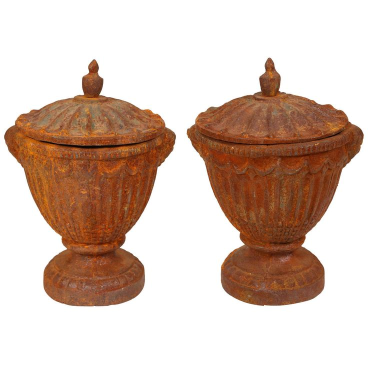 Pair of Vintage Iron Urns | From a unique collection of antique and modern urns at https://www.1stdibs.com/furniture/building-garden/urns/