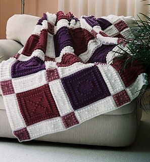 """This crocheted blanket is an original design that is easy to complete. The entire blanket requires only three crochet stitches - chain stitch, single crochet and the popcorn stitch. The pattern includes the instructions, a list of materials and the yarn amounts needed for a finished blanket approximately 53"""" x 60""""."""