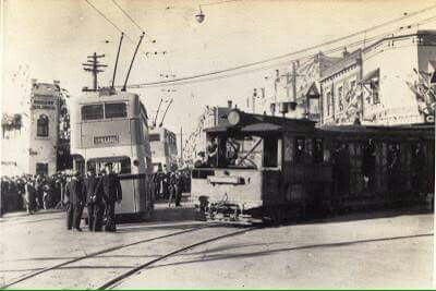A new Trolley bus and the last tram in 1937 at Railway Parade,Kogarah in southern Sydney.