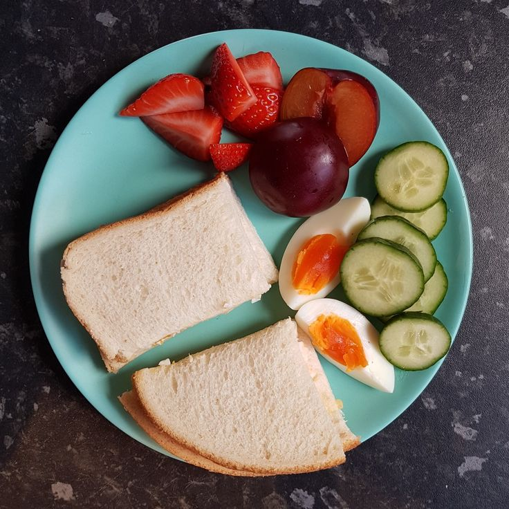 Teddy lunch: egg mayo sandwich, boiled egg, cucumber, plum and strawberries