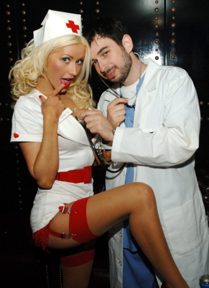 Pin for Later: 55+ Celebrity Couples Halloween Costumes Christina Aguilera and Jordan Bratman as a Naughty Nurse and Doctor