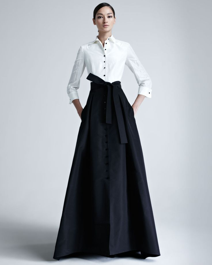 Carolina Herrera Taffeta Gown - Neiman MarcusClassically designed shirt adjoins feminine, A-line skirt. An archetypal bow ties self belt. The look is tailored, yet womanly. Style with canary diamond earrings for a surprising finish.  Two-tone silk taffeta.  Convertible spread collar with contrasting buttons.  Three-quarter sleeves with French cuffs.  Skirt has self belt.  Slash pockets.  Softly pleated, A-line skirt.  Floor-sweeping hem.  Made in USA.Carolina Herrera  Taffeta Gown  GBP…
