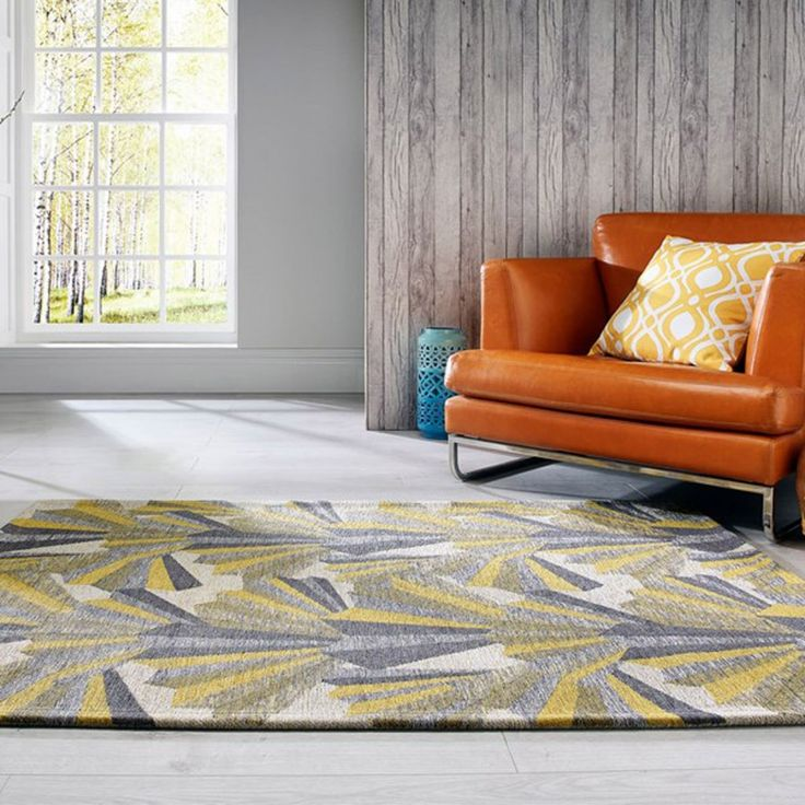 The fabulously designed V&A Fanfare Ochre Wool Rug, platters an abstract pattern with beautiful colours and is the fashion icon of Rug World. #FlairRugs #TheRugShop #AbstractPattern #NewArrival