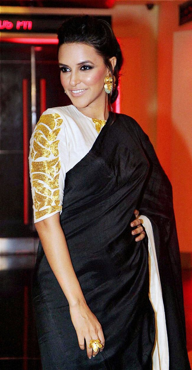 Neha Dhupia. Focus on the sleeves, not the saree border...