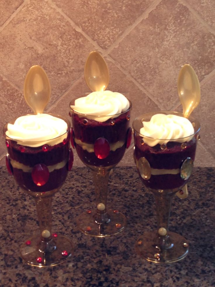 Made these faux goblets for a Hamlet party with plastic gold wine goblets and plastic jewels.  Put a white sixlet candy to represent the pearl dropped in the Hamlets goblet by Claudius.  I put red velvet cupcake in the goblet but you could use any flavor. Then I used clear address labels with quotes from the play to attach the spoons.  Fun project!