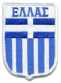The patch reads;  Ellas. I don't know what it means, but I can read Greek Y'All!!! I can also write in Greek, I speak only a little now, but I'm working on it.