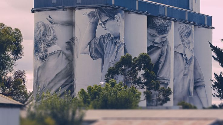 A famous Aussie artist has put one small town on the map with his paintings of local kids. The unique thing about these paintings though is that they're 35 metres tall and on the side of massive grain silos.