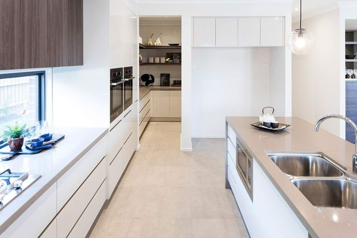 With stylish finishes and modern features, you'll love this stunning kitchen. #weeksbuildinggroup #homedesign #interiordesign #newhome