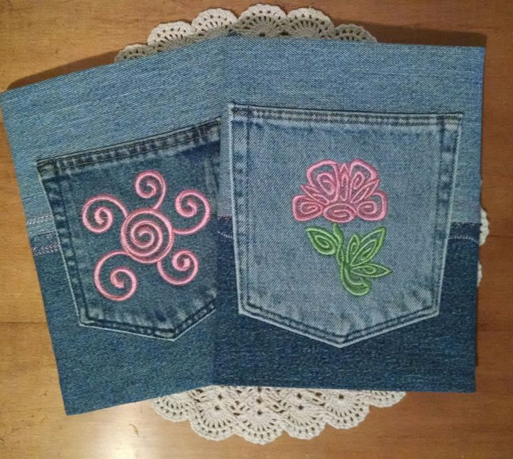 Repurposed denim composition notebook covers. Machine embroidered pockets.