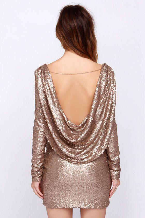 Falling hard for sequins this season? Take the trend one step further with our Crossed the Line Gold Sequin Dress! Dazzling gold sequins cover this sexy number, from its surplice neckline, down the long sleeves, and through the fitted waist and skirt. For added glamor, a single gold chain at back crosses at the shoulders, topping a panel of draping fabric. Hidden side zipper. Fully lined in beige stretch knit. 100% Polyester. Hand Wash Cold.