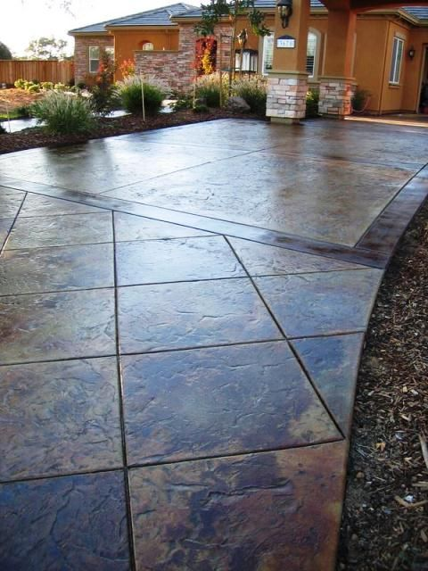 """Elite Crete Systems: """"This driveway was overlayed with TEXTURE-PAVE™ Pre-Mixed Overlay to create what is referred to as a """"Thin Stamped Overlay"""" creating a subtle slate finish. Then CHEM-STONE™ Reactive Stain (also known as acid stain) was applied to give it the worn natural look. Finally, the entire surface was sealed and protected with CSS EMULSION™."""""""
