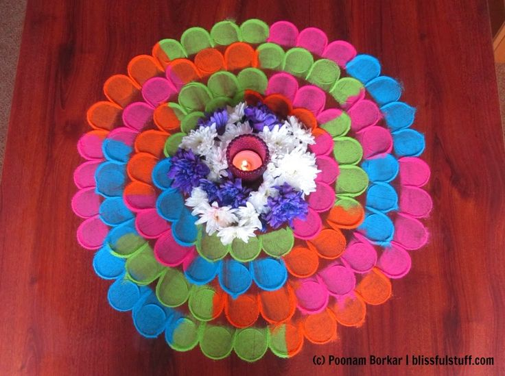 Quick and easy multicolored flower shaped rangoli using tealight candle ...