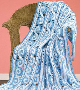 Spiral Crochet Afghan  The spiral crochet stitch used to create this afghan crafted in colorways inspired by a blue lagoon yields a blanket with the look of frothy waves--a beautiful accent piece for a seaside cottage (or a room decorated like one). Skill Level: Experience necessary Crafting Time: Varies Skill Level: Experience necessary