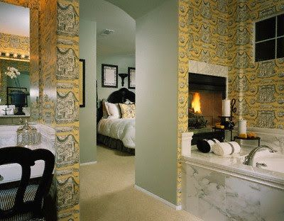 I like the idea of the double sided fireplace between the bath and the bed rooms for a master suite.