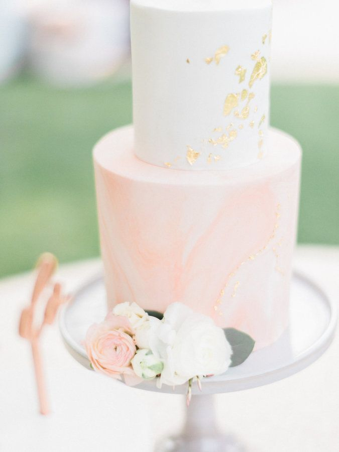 Blush marble cake with gold lead flakes: http://www.stylemepretty.com/2016/06/30/this-couple-gave-guests-the-donut-bar-of-our-dreams/ | Photography: Honey Honey Photography - http://www.hoooney.com/