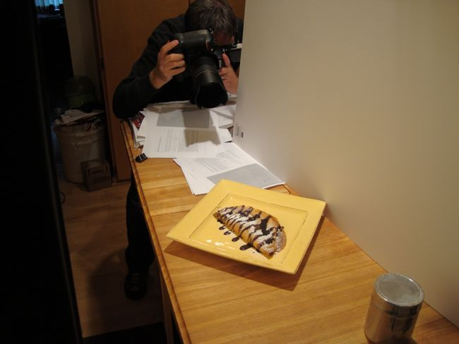 Kelly Gorham, my photographer, shooting a crepe soufflé just out of the oven and decorated with powdered sugar and chocolate. https://www.facebook.com/media/set/?set=a.532071946885594.1073741826.216578811768244&type=1&l=0ebe066837