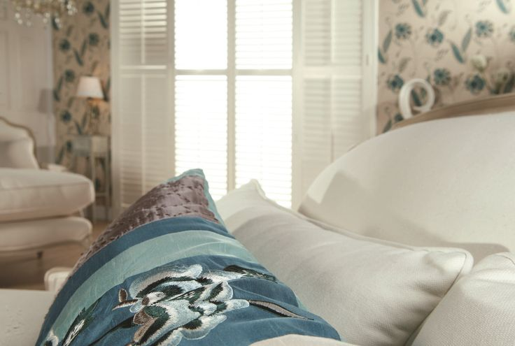 White bedroom shutters by Apollo Blinds. Modern window dressing. Contemporary bedroom design inspiration. White and teal home decor.