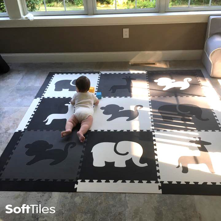 SoftTiles foam play mats create a soft spot on this stone floor! Use directly on hardwood, concrete, tile, or marble floors.