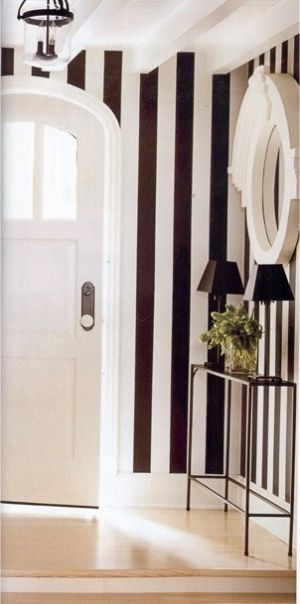 Love the black and white foyer