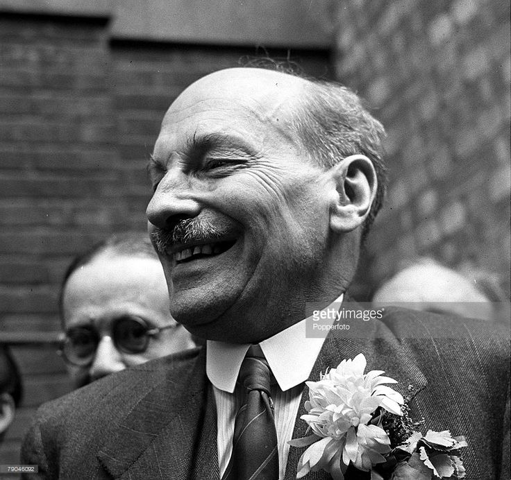 26th July 1945, London, England, British Labour politician, and now Prime Minister, Clement Attlee is pictured celebrating after his victory in the General Election