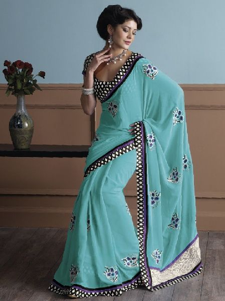 This Indian Sari is the fashionable and unique black and white pattern broad border running all over the Indian Sari finished with purple and black thin lace. $74