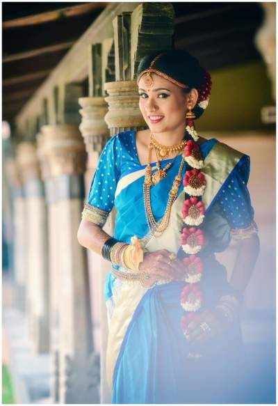 South Indian Bride - Bride in a Blue and Gold Kanjivaram Saree with Floral Hair Detailing | WedMeGood #wedmegood #indianbride #indianwedding #southindianbride #southindianwedding #kanjivaram #saree