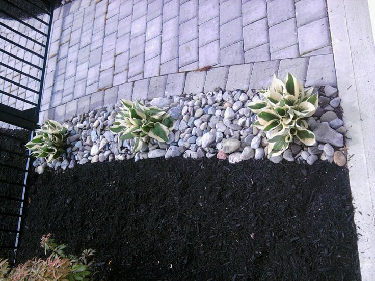Black mulch landscaping ideas flower bed ideas for Landscaping rocks and stones near me