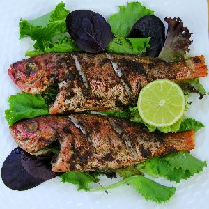 Simple Oven Jerk Fish Recipe. Used Walkerswood jerk seasoning on one 2-lb yellowtail snapper. Very tasty and spicy.  I've also used this recipe with Bronzini - it was even better - really absorbs the flavor. Broiled it for a few mins at the end of cooking.