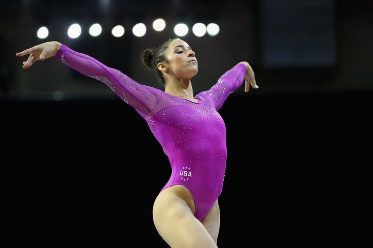 Aly Raisman Photos Photos - Alexandra Raisman of the United States competes in the floor exercise during Day 2 of the 2016 Pacific Rim Gymnastics Championships at Xfinity Arena on April 9, 2016 in Everett, Washington. - 2016 Pacific Rim Gymnastics Championships - Day 2