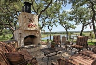 Eclectic Patio with Coffee table, stone fireplace, O.w. lee ashbury sofa, exterior stone floors, outdoor pizza oven