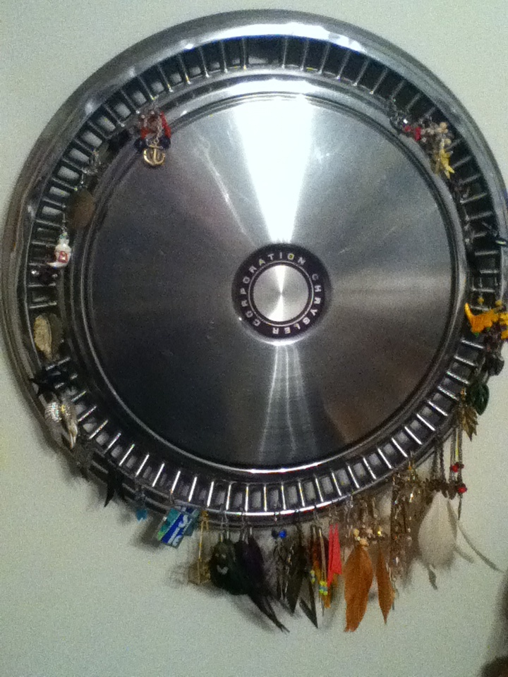 Use an old hubcap to hang earrings:)