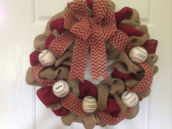 This is a baseball inspired burlap wreath. Made with red burlap, burlap, and red chevron burlap ribbon. These are real baseballs on a wired