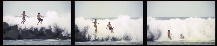 dangerous fun with hurricane iniki swell. photograph by cory Lum.