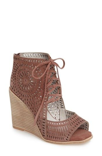 Free shipping and returns on Jeffrey Campbell Rayos Perforated Wedge Sandal (Women) at Nordstrom.com. A celebration of angles and textures radiates brilliantly from twin perforated medallions adorning the shaft of a bootie-profile sandal reimagined with the signature inventiveness of Jeffrey Campbell. A gorgeously proportioned wedge ramps up both the playful personality and the high-top silhouette, while a blunted toe and an open vamp emphasize the importance of making a memorable entrance.