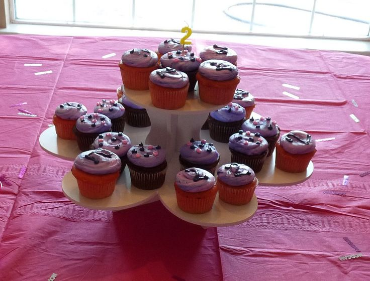 2nd Birthday Flower Cupcake Tower Display: http://www.thesmartbaker.com/3-tier-flower-cupcake-tower/