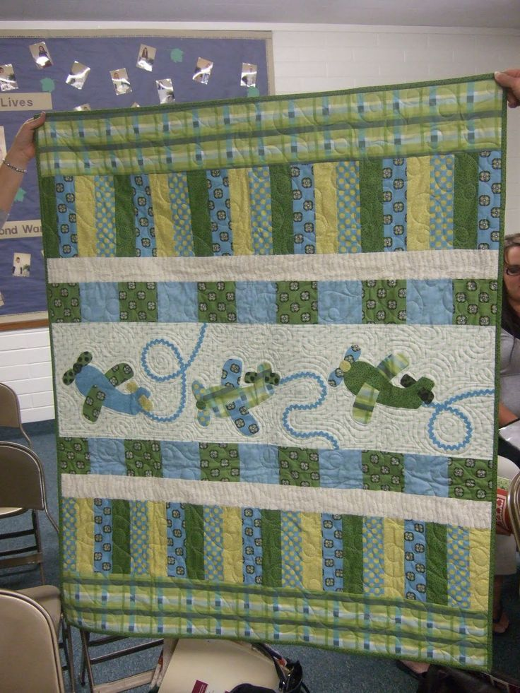 Jina Barney Designz shows this quilt from a show and tell that she attended on her blog. I don't know the designer or the maker, but would be happy to post them if someone can identify them for me.