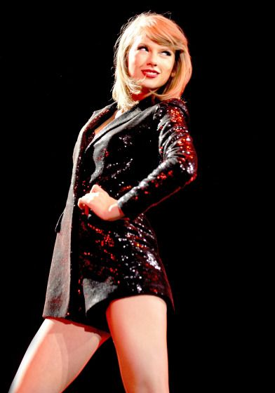 Taylor Swift sparkles and shines during her 1989 World Tour in England.
