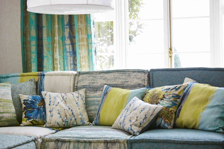 Create a cheerful seating area with a mix of cushion sizes, shapes and patterns. We've chosen a selection from our Fauvisimo and Sgraffito fabric collections.