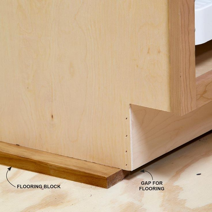 Raise the Cabinets for Flooring - Install Cabinets Like a Pro!: http://www.familyhandyman.com/kitchen/diy-kitchen-cabinets/how-to-install-cabinets#10