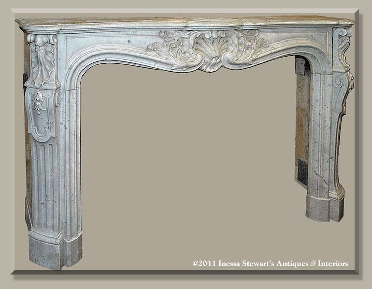Antique French Regence fireplace mantel surround hand-carved from solid Carrara marble