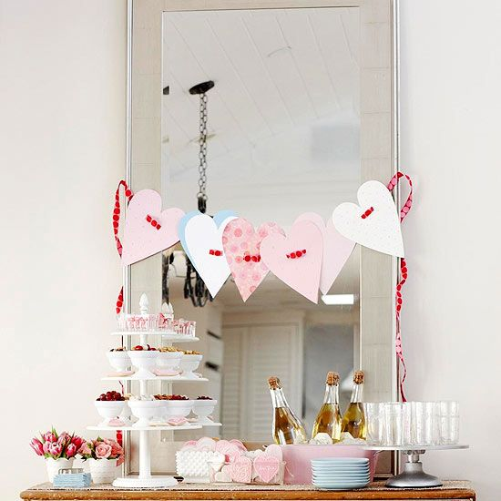 A Beribboned Hearts Garland is a simple and whimsical way to add Valentine's Day flair to your home. #ValentinesDay