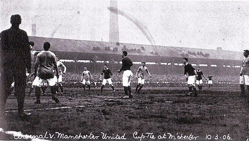This photograph shows the FA Cup 4th round match with Woolwich Arsenal played at Bank Street  in 1906. The match ended 2-3. In the background we can see the chimneys of one of the chemical works. Fantastic also to see the Edwardian attitude to spectator safety, with the fans on the roof of the stand.  Before The 'D'...Association Football around the world, 1863-1937.: Manchester United