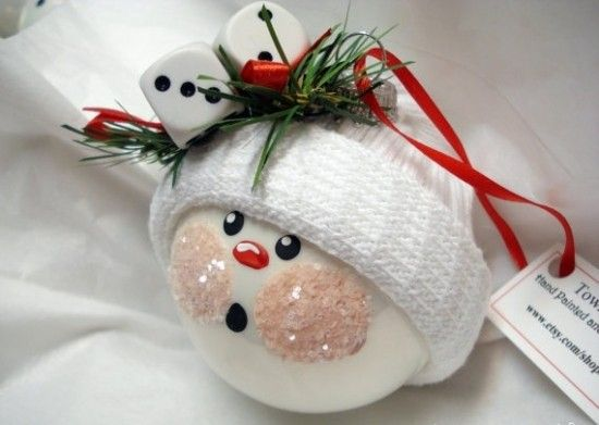 Snowman ornament: a ping pong ball, a baby sock, jingle bells, ribbon, greenery, glitter and some paint.
